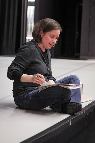 Director Alison Humphrey (MFA 2013) gives notes during rehearsal for A Midsummer Night's Dream on the stage of the Faire Fecan Theatre.